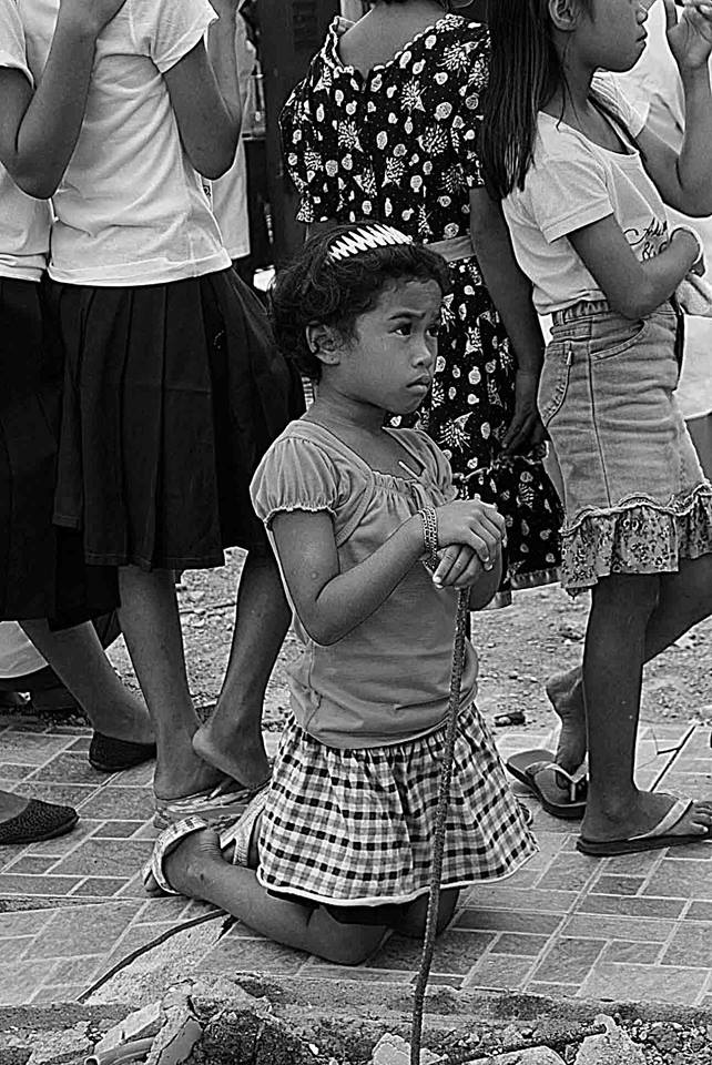 A young child in deep prayers as she attended the Mass celebrated by Robert Cardinal Sarah at the Saint Elizabeth of Hungary in Libertad, Palo on January 28. (TOTEX ARCUENO)