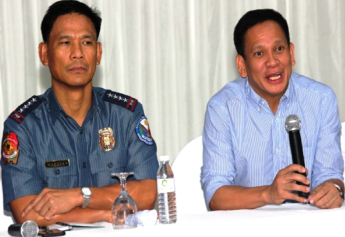 """HARD AND HURT. Interior Sec. Mel Senen Sarmiento(right) said that he was hurt as Calbayog being labelled as """"killbayog,"""" prompting the country's top police cop, Director Gen. Ricardo Marquez, that they would get hard against criminals in the city to ensure a peaceful conduct of election this May 9, 2016. (HENRY PUYAT)"""