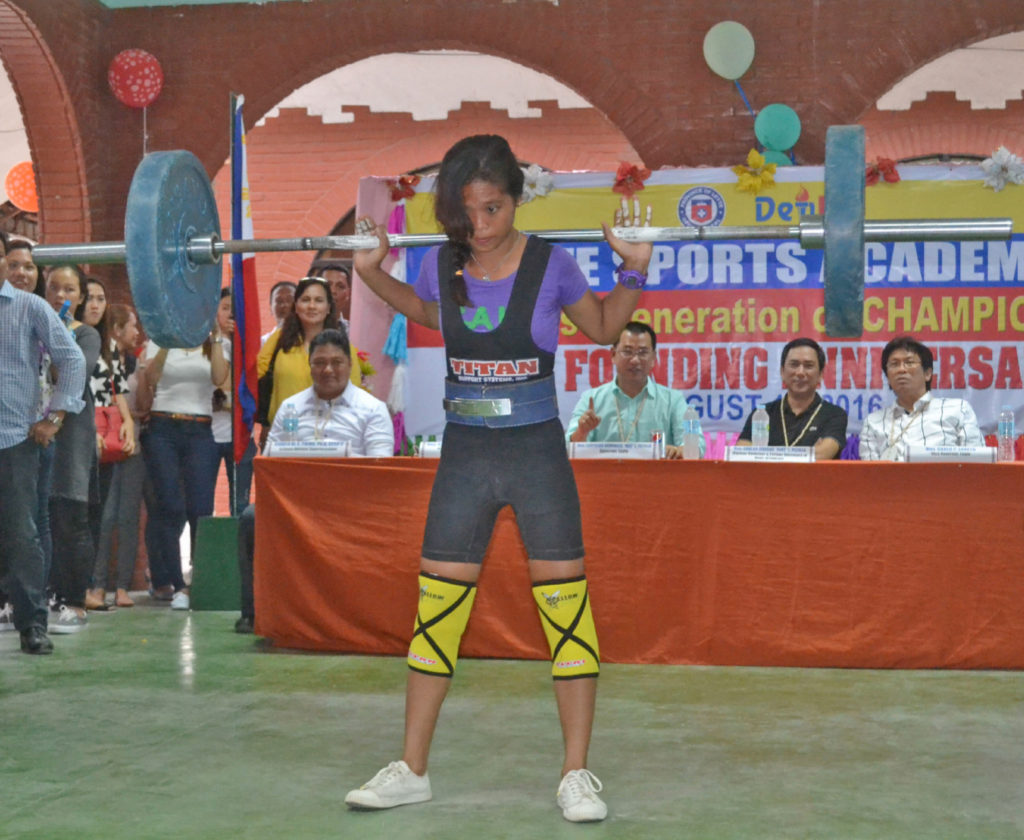 Leyte Sport Academy (LSA)  scholar Veronica Ompod, 15 year old of Matag-ob Leyte, who won a gold medal at the World Classic Power Lifting Championship last June this year demonstrates before her audience during the 6th LSA anniversary how she won the gold medal at the World Classic Power Lifting Championship. (Photo by: Restituto A. Cayubit)